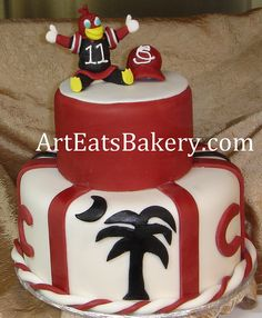 USC Gamecock two tier garnet and black fondant cake with palmetto tree, baseball cap, and cocky figure by arteatsbakery, via Flickr