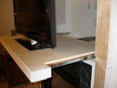 Pull out alcove tv shelf