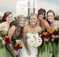 Green bridesmaid dresses with contrasting autumn bouquets