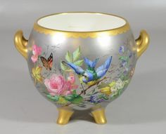 """c1850 latinum ground & gilt hand painted floral, butterfly, & bird decorated footed & handled porcelain bowl, unmarked, may be N Vivien, Lebeuf & Co, c 1850, 7 3/8"""" h, 10"""" extreme width. Sold $786.50 Decorative Vases, Violets, Vases Decor, Decoupage, Floral Design, Butterfly, Hand Painted, China, Ceramics"""