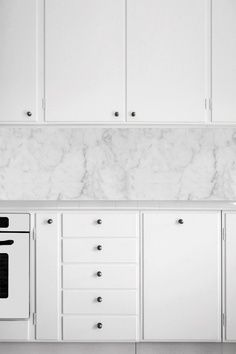 Marble benchtops & white kitchen cabinets. Clean & simple design, that really creates visual impact.