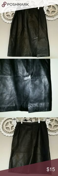Genuine leather black skirt Add extra sex appeal to your outfit with this black leather skirt. Whether you dress it up with a sparkly top or pair it with a buisness casual top for the office; it will be a winner. Measurements length from waist 24 inches to bottom  and waistline 13inches. Material 100% genuine leather; lined with polyester. No imperfections.  Comes from non smoking home Mixit Skirts Midi