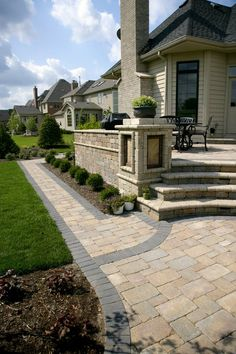 Brussels Block® Coffee Creek Blend Walkway with Hollandstone™ Charcoal Blend border by Unilock