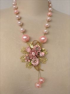 Lovely assemblage necklace made using wonderful soft pink floral brooch, and new filigree and beads.Made by Catherine Otto