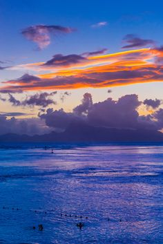 sunset over the island of moorea seen from manava suite beach resort punaauia