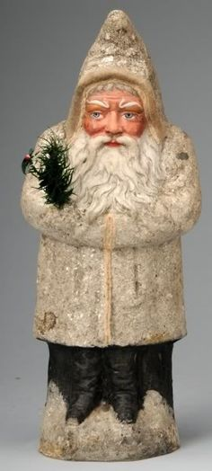 Antique White Coat Belsnickle with feather tree sprig and mica glitter.