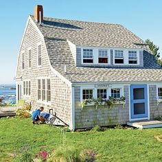 Beach Cottage: Hal and Mary Quayle fell in love with this 100-year-old cottage on Bailey Island Maine and after some simple touch-ups turned it into a cozy hideaway with thrilling views. They embraced the cottages quirky character and celebrated its aged-to-perfection charm. #beachcottagesdecor