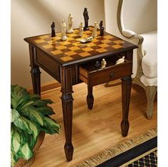 """Checkmate!"" Position this authentic hardwood game table between two chairs for a casual romp through the game of kings. With a walnut-hued finish and a hand-painted tabletop, at $175.00  http://www.bboescape.com/products/buy/225/gifts/Walpole-Manor-Gaming-Chess-Table"