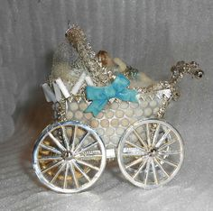 Sebnitz Baby Carriage with wax baby. By Betsy Browning