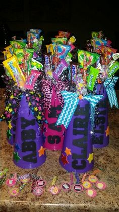 Cheer birthday party. Cheer megaphone candy bouquets personalized for each guest with cheer hair bow.