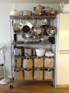 Hang pots and pans from bakers rack