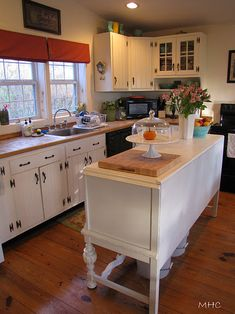 i like how she used this buffet/sideboard as a kitchen island.