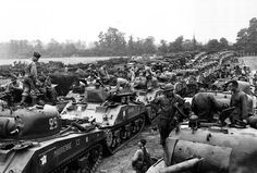 Sherman tanks and other vehicles of the French 2nd Armoured Division shortly after landing on Utah Beach. #WW2