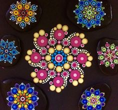 June's Pattern Club #mandala in the middle. This month, members from ten countries dot this design for the Scottish Association for Mental Health. The #TravellingKindnessRocks pictured are already on their journeys to locations throughout #Canada and #USA. #weareone #connected #spreadlove #mandalas #dotting #dotart