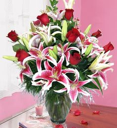 Romantic Beauty - Red roses paired with stargazers, creating a full look for the one you love