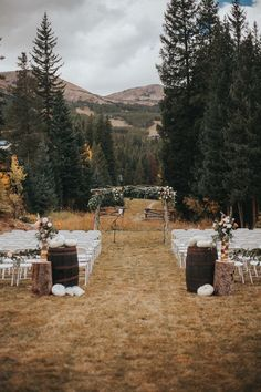 Fall outdoor mountain wedding ceremony with white pumpkins and lush florals   Image by Cork Creative