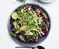 Crunchy slaw with peanut-lime dressing recipe - For dressing, heat oil in a small saucepan over medium-high heat, add shallot, garlic and chilli and sauté until softened (2-3 minutes), then transfer to a food processor, add remaining ingredients and process until smooth. Season to taste.