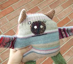 Knitagain pig - squeezy barnyard friend with a curly tail.   Made from recycled sweaters.$32 at kittyallen.etsy.com