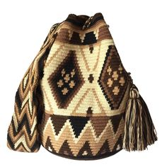 www.lombiaandco.com All bags are made and purchased from the La Guajira,Colombia, where the indigenous Wayuu community live and crochet these beautiful mochila bags. #wayuumochilabag #doublethreadwayuubag Tapestry Bag, Tapestry Crochet, Handmade Handbags, Tunisian Crochet, Smocking, Vivid Colors, Bucket Bag, Purses And Bags, Boho Chic