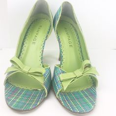 """Green Blue Plaid D'Orsay Heel Rampage Size 8 Used Heels have nicks in them affecting the appearance of the heel (see photos). These are used shoes and not in new condition. There is a heel grip placed on both sides. Size 8 Rampage. Blue and Green. Heel size - 3.25"""". D'orsay style with bows. Open toe. Rampage Shoes Heels"""