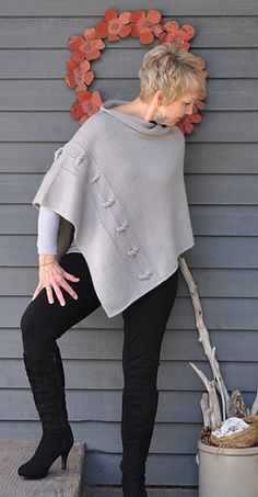 """Knitters at the level of Advanced Beginner through Expert will enjoy creating this fashionable, innovative yet classic poncho. The """"Knotted Chain"""" Poncho is a versatile piece for every occasion and is full of gentle elegance making it a wardrobe staple."""