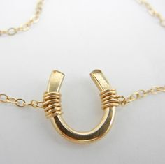 14k Gold Fill Horseshoe Necklace. 14k Gold fill chain. Handmade in the San Francisco Bay Area, California, USA.