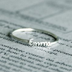 Sterling silver cursive name ring. $30 + $2.50 a letter. I'd love to have a couple with my kids' names on them.