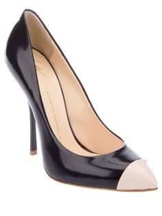 Navy blue leather pump from Giuseppe Zanotti featuring a pointed toe, a leather covered stiletto heel, a contrasting nude panel detail at the toe and a leather sole.