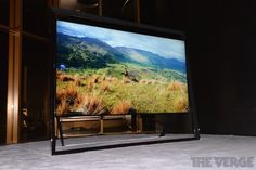 Samsung 85-inch UN85S9 4k TV. I love the stand. This set would go great with modern decor.
