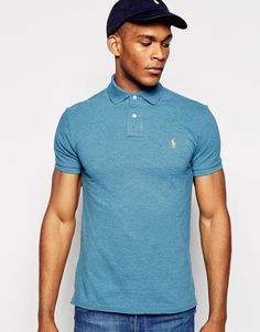 "Polo shirt by Polo Ralph Lauren Breathable cotton pique Ribbed collar and cuffs Embroidered polo player logo Two button placket Split, stepped hem Slim fit - cut closely to the body Machine wash 100% Cotton Our model wears a size Medium and is 188cm/6'2"" tall"
