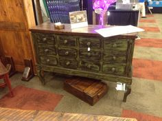 Apothecary with distressed green finish and reclaimed black walnut top.