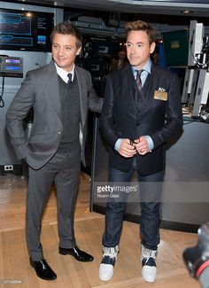 Actors Jeremy Renner and Robert Downey Jr. visit the New York Stock Exchange on April 27, 2015 in New York City.