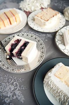 Slices of white cake with colorful fruit fillings