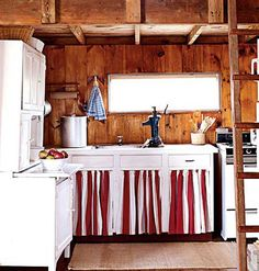 The charm of this kitchen comes in its rustic wood paneling and whitewashed cabinets. Reminiscent of a log cabin, this kitchen may be small on square footage but more than makes up for its size with attractive details. From Coastal Living.
