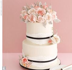 Beautiful 2 tier cake with black trim and pink flowers