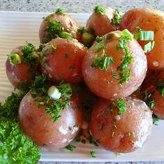 New Potatoes with Caper Sauce | Hot cooked new potatoes are gently tossed in a tangy, rich sauce of capers, parsley and grated Parmesan for a side dish that will steal the show.
