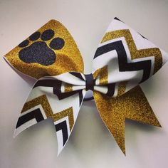 Buy White, gold and black glitter paw and chevron cheer bow by bragaboutitcheerbows. Explore more products on http://bragaboutitcheerbows.etsy.com
