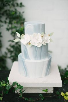 Blue Grey and White Marble Three Tiered Minimalist Wedding Cake with Ivory Sugar Flowers with Green Leaf Accent | Tampa Wedding Cakes and Desserts Hands on Sweets