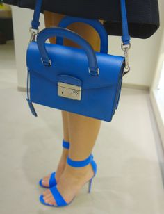 Small Prada saffiano shoulder bag in blue, combined with Gianvito Rossi blue suede high heel sandals. Spring summer 2014. www.wunderl.com