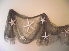 Deluxe: Coastal, beach, nautical home decor, starfish wedding decor, seashell, beach wedding decor, authentic fishing net and star fish by UptownGirlzz on Etsy https://www.etsy.com/listing/158239312/deluxe-coastal-beach-nautical-home-decor