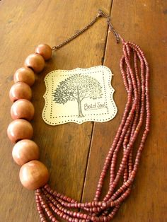Long Multi-Stranded Metallic Purple Beaded and Wooden Beaded Necklace. $30.00, via Etsy.