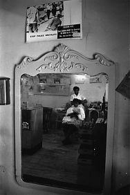 Vera Mae Pigee with a customer in her Clarksdale beauty shop, c.1961. (Charles Moore photograph/ copyright Charles Moore Estate/BlackStar Inc.) | Vera Pigee owned and ran a beauty salon where she organized for the Civil Rights Movement, ran citizenship classes to teach literacy skills, and made a living. In her salon she talked about the movement with her clients, went through the voting registration papers with them, and organized events while she worked on their hair.