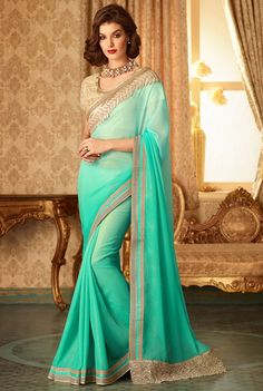 Buy Saree Online With SareeGalaxy - Green Georgette Saree with Blouse - Get It Here: http://www.sareegalaxy.com/women/sarees/green-georgette-saree-with-blouse-svd91w68314-sg