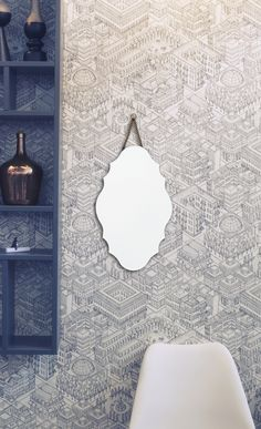 Frameless glass mirror with metal hanging chain
