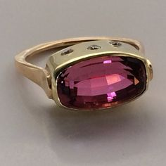 This pink tourmaline gemstone is a special stone that is mined in the mountains of Western Maine. The size and royal quality of this stone