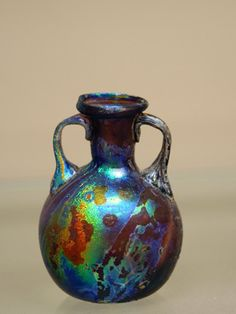 Why is Some Ancient Glass Iridescent? Some of the ancient glass displayed in… Glass Vessel, Glass Ceramic, Mosaic Glass, Antique Bottles, Antique Glass, Vases, Toledo Museum Of Art, Glass Pavilion, Art Of Glass
