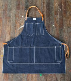 325 Artisan Apron in Cone Selvage Denim & Horween Leather Artifact Bags. Think I need one of these for my ceramics days. Leather Apron, Saddle Leather, Tan Leather, Barber Apron, Work Aprons, Gardening Apron, Sewing Aprons, Denim Aprons, Denim Shirts