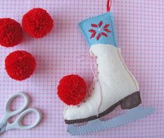 Ice Skating Afternoon Felt Ornaments - Pompoms for Skates on Pretty by Hand at http://prettybyhand.com/blog/2013/1/21/pom-pom-awesome.html