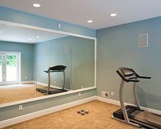 Small workout room attached to family room (in basement) with two way mirror between to work out/quiet alone time and also keep an eye on kids!