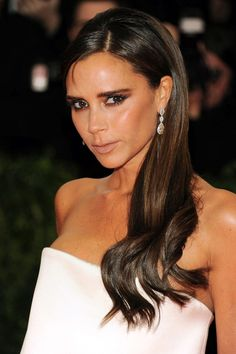 For the modern bride: Victoria Beckham's glossy, side-parted and bronze smoky eyes make the perfect beauty combination!